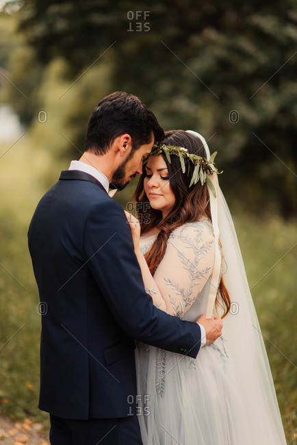 Bridal couple in a tender hug