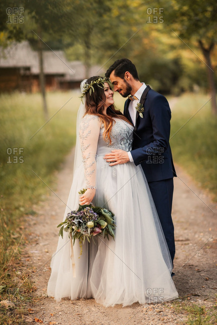 Bridal couple in a hug on dirt road