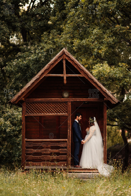 Bride and groom on cabin porch