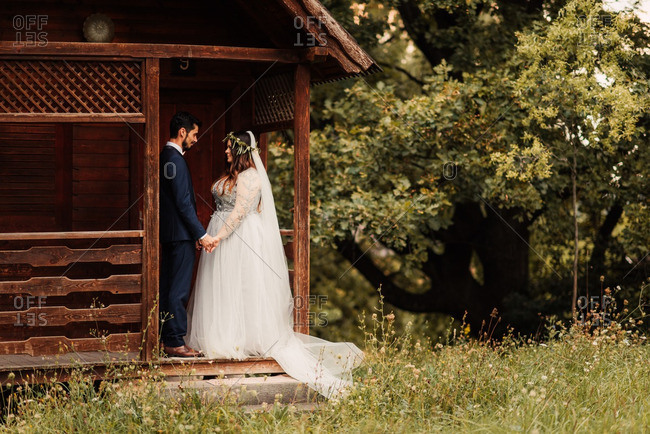 Bride and groom on a cabin porch