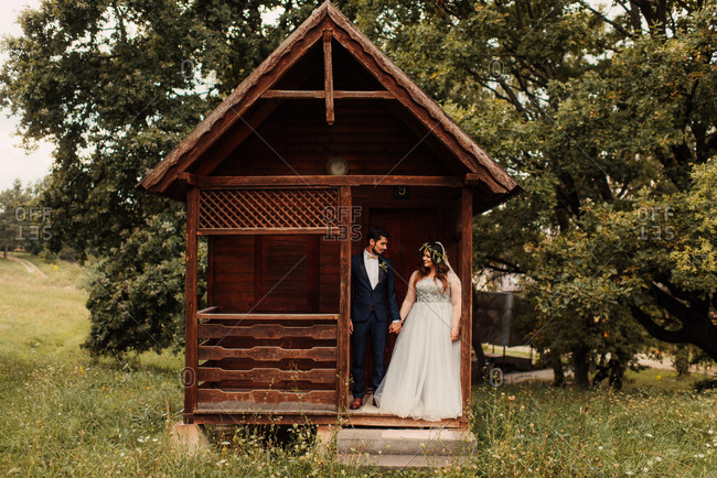 Bride and groom together on cabin porch