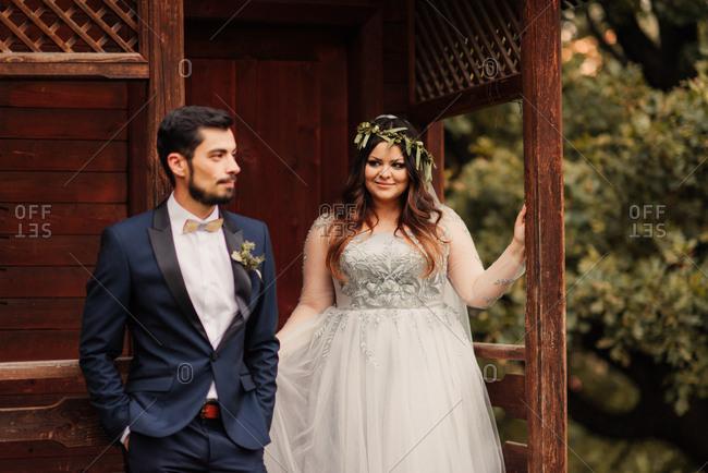 Bridal couple on a cabin porch