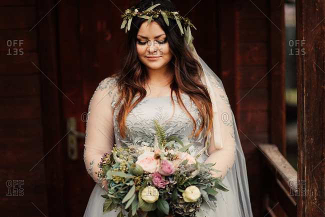 Bride with her bouquet on porch