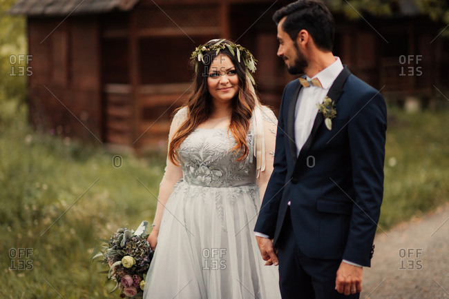 Bride and groom walking near cabins