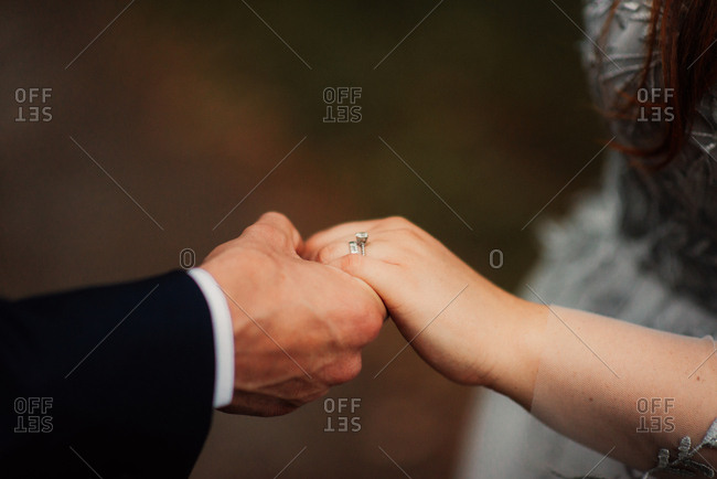 Wedded couple holding hands