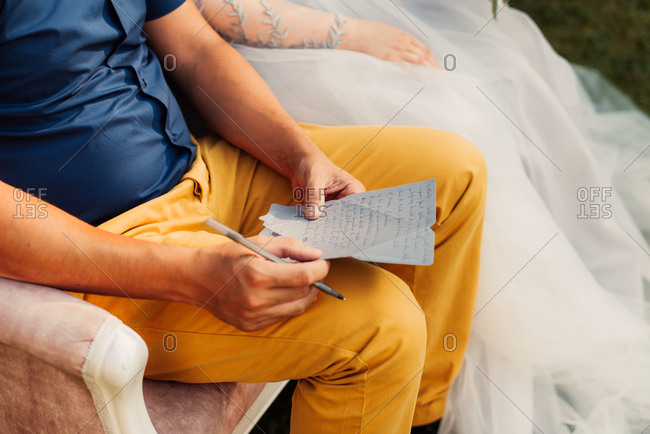 Bride next to man writing notes