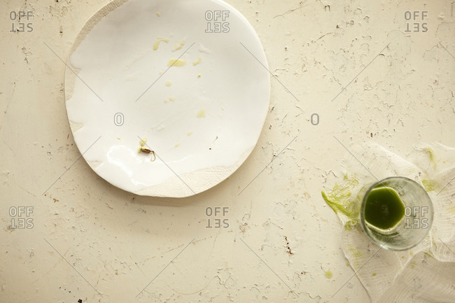 Dirty glass and plate on stone background