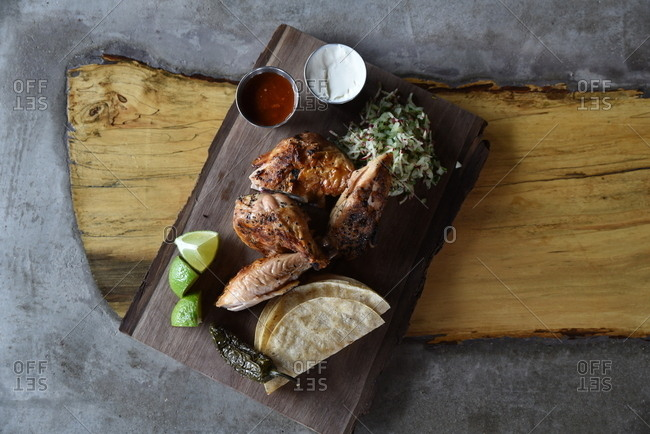 Chicken tortillas on wood board