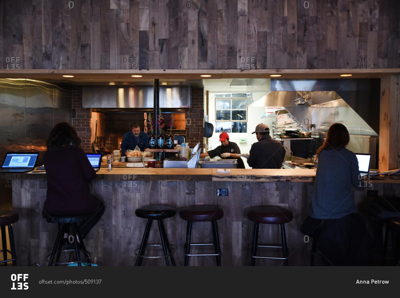 january 26, 2017: people workingopen restaurant kitchen stock