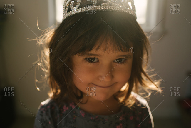 Close up of little girl wearing crown