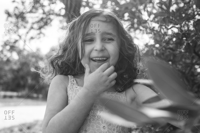 Little girl laughing in black and white