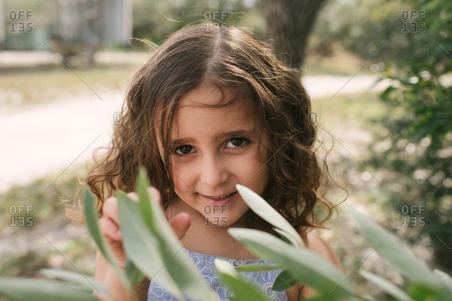 Smiling little girl with curly brown hair