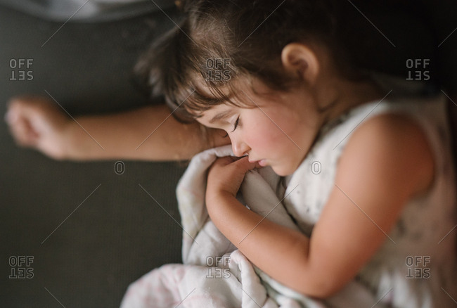 Overhead view of a little girl sleeping