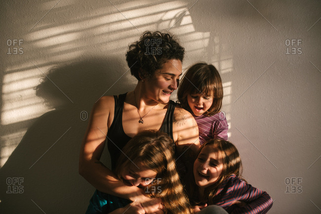 Mother with three daughters laughing