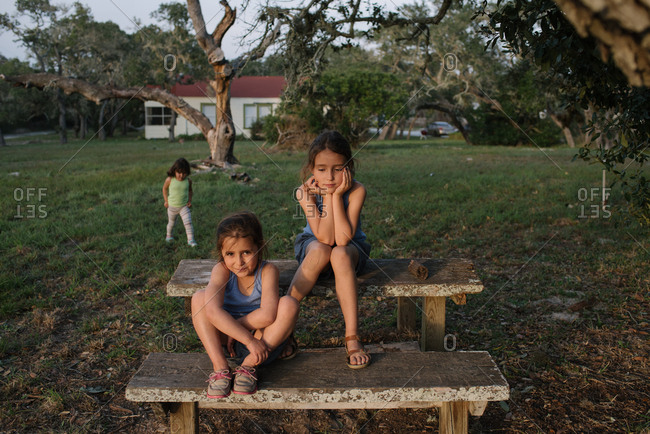 Young girls playing on a picnic table