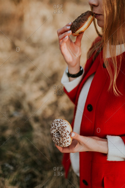 Young woman eating donuts