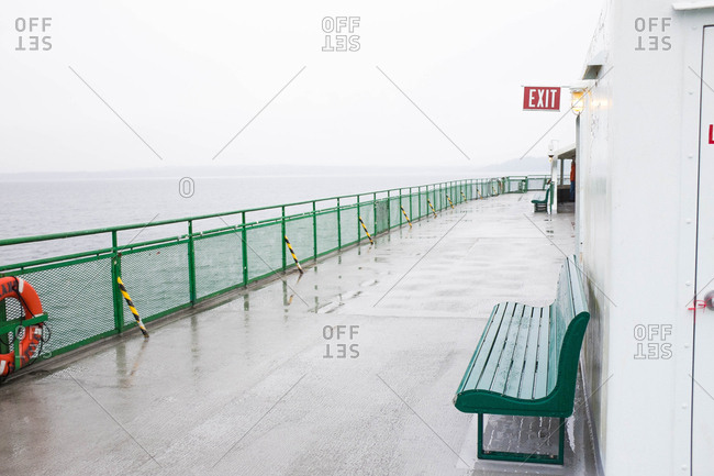 Bench and guardrail along upper deck of ferry sailing on Puget Sound