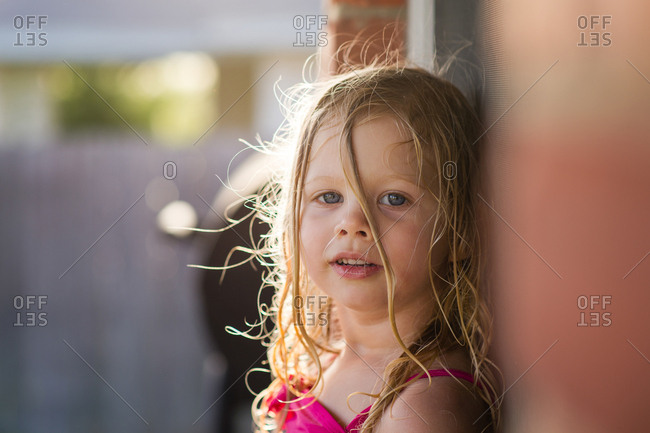 Girl with wet hair standing outside