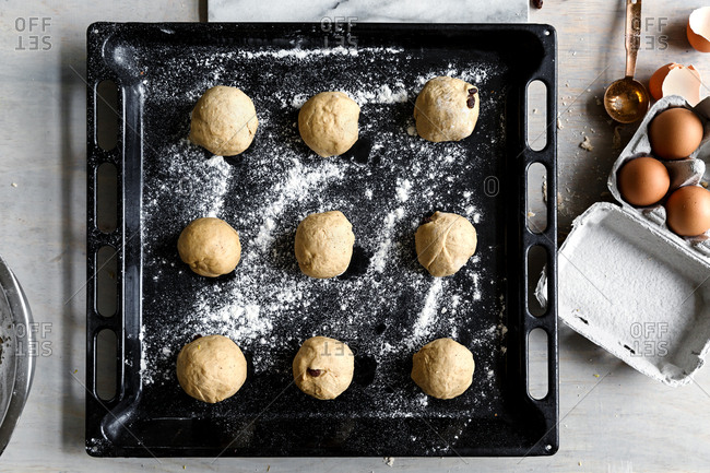 Shaped hot cross bun dough balls