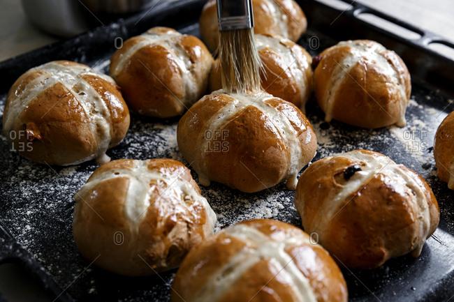 Glazing hot cross buns side angle