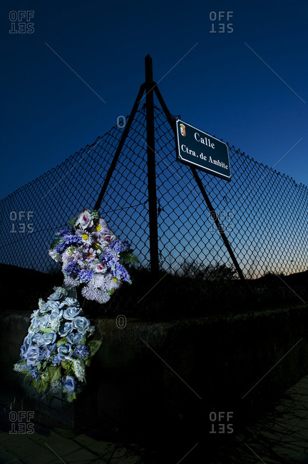 Flowers bouquet attached to a barbed wire to remember those who died on the road, Spain