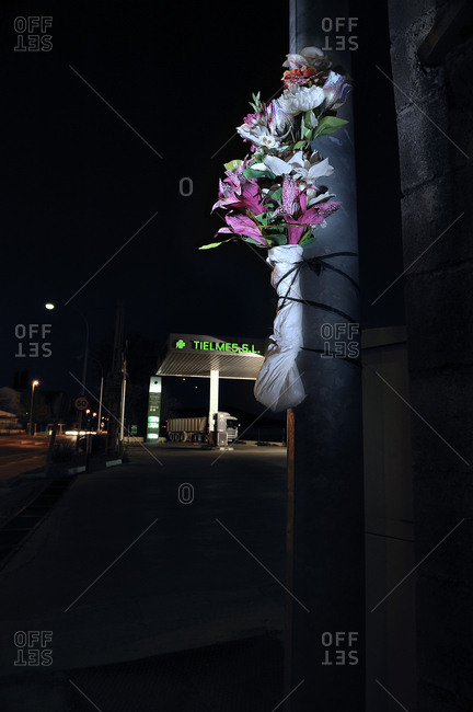 Spain - May 1, 2009: Bouquet of flowers tied to a pole to remind those who died on the road, Spain