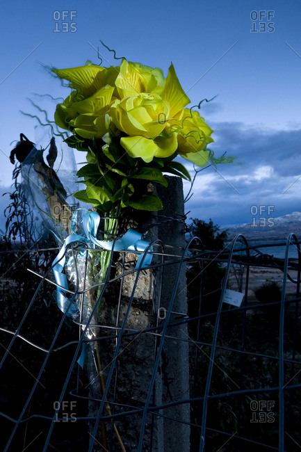 Bouquet of flowers tied to a pole to remind those who died on the road, Spain