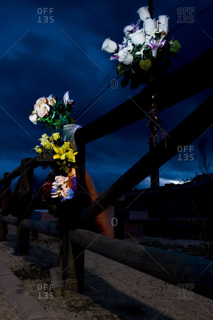 Flowers bouquet attached to a pole to remember those who die on the road, Spain