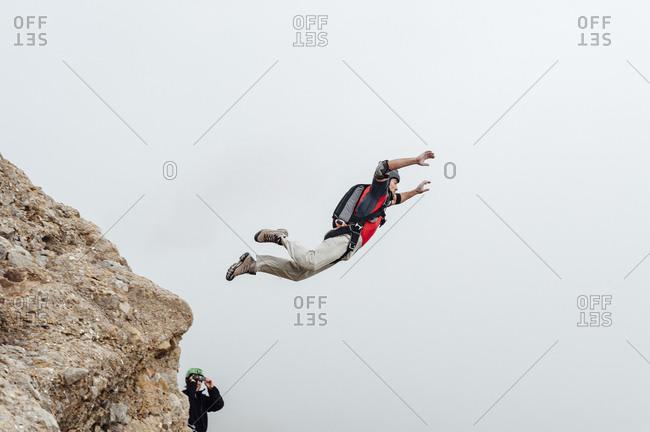 Base jumper Carlos Suarez jumps from los Mallos de Riglos in Riglos, Spain