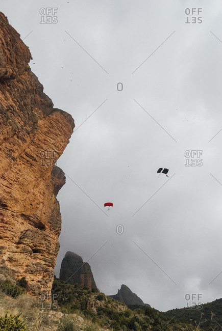 Base jumpers with the parachutes in los Mallos de Riglos, Spain