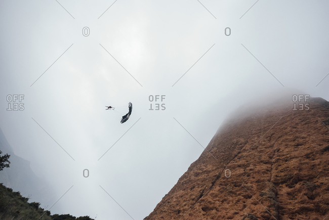 Base jumpers in los Mallos de Riglos on a foggy day in Riglos, Spain
