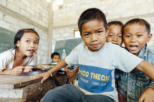Tha Kaek, Laos - November 25, 2010: Kids looking at the camera in a rural school in Tha Kaek, Laos