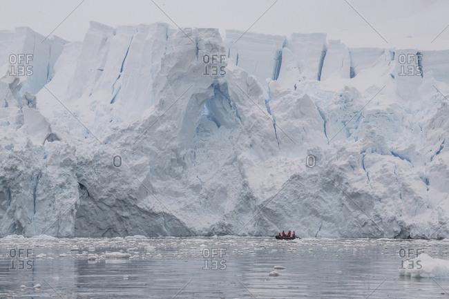 A Zodiac cruises near a glacier face in Paradise Bay, Antarctica