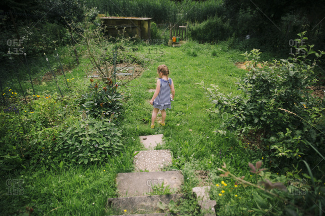 Girl exploring a rural yard