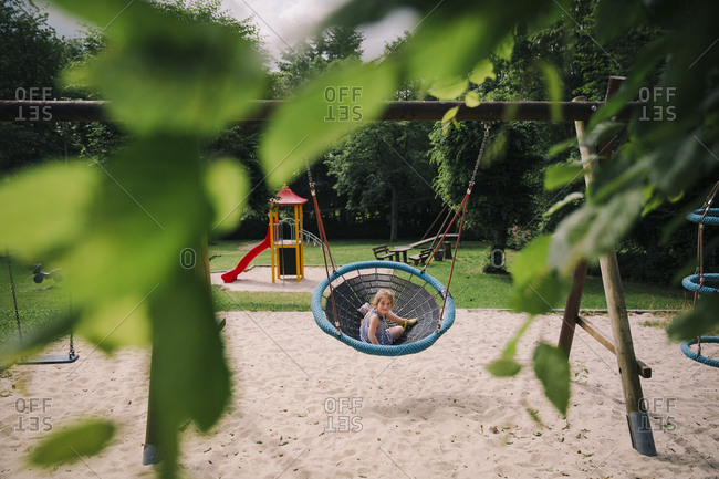 Girl swinging in a rural playground