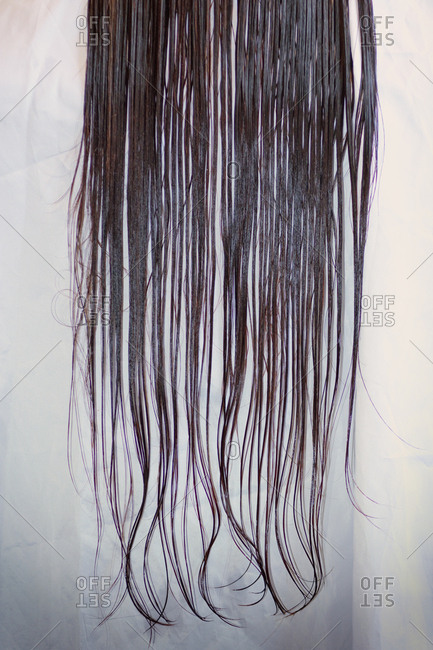 Close up straight wet long dark hair hairdressers