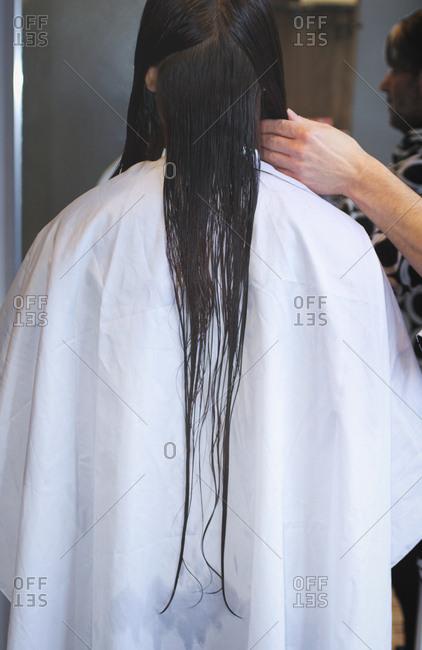 Hairdresser stylist styling long hair salon mirror
