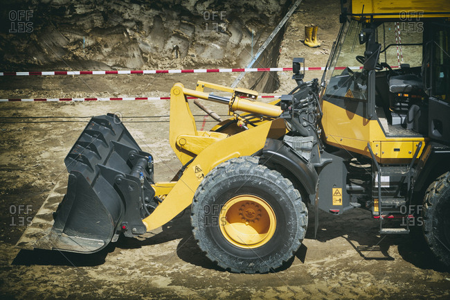 Yellow excavator digger earth mover construction