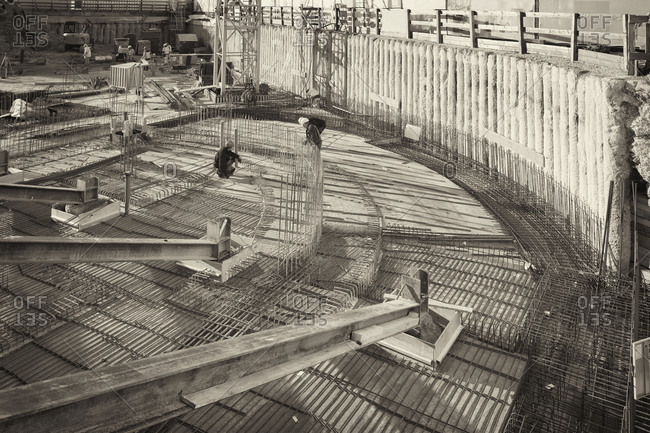 Munich, Germany - March 16, 2016: Building construction site fundament men working