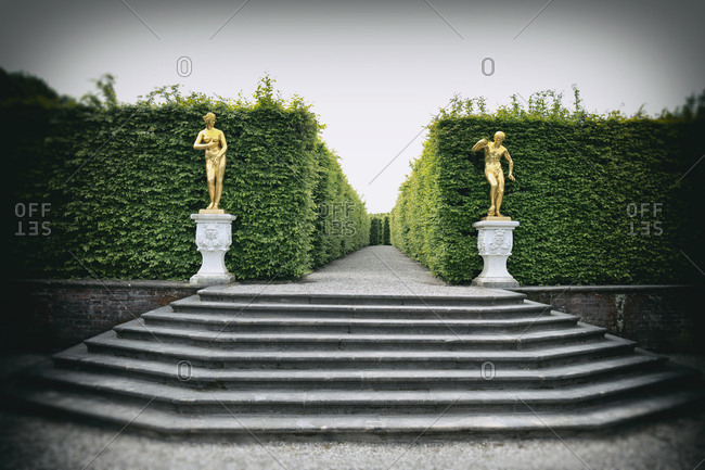Palace gardens golden sculpture statues hedgerow