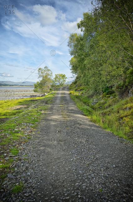 Coastal low tide beach path mountains landscape