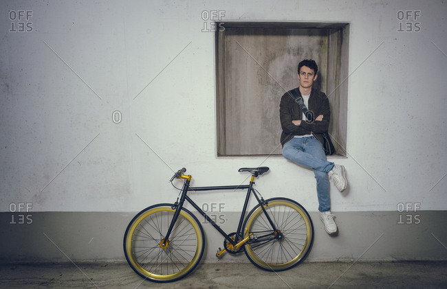 Young cool man posing fixie bicycle Hipster trendy