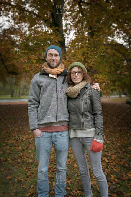 Young heterosexual couple autumn smiling 20s 30s