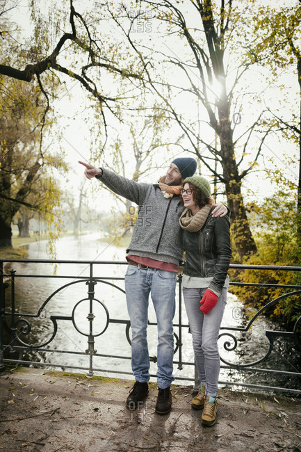 Man woman couple autumn laughing pointing sunshine