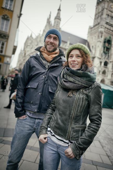 Young heterosexual couple winter city portrait 20s