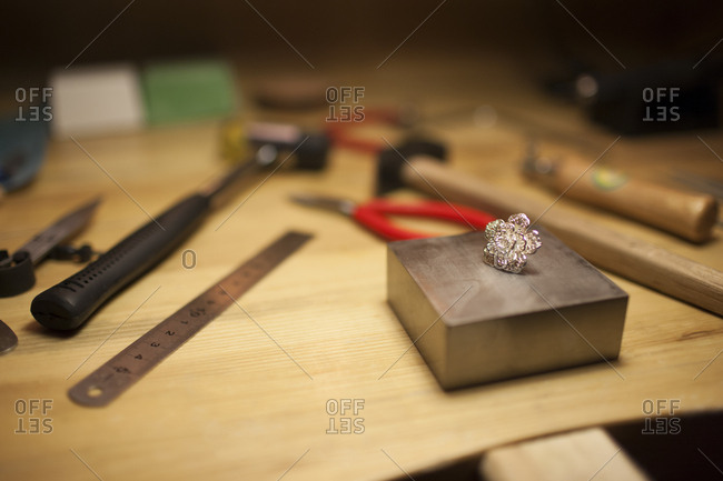 An earring on jeweler's workbench