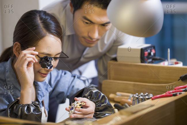 Jeweler examining jewelry with loupe
