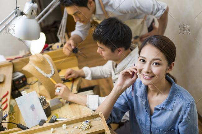 Jewelers working in studio