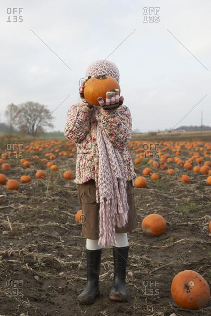 Portrait of Girl in Pumpkin Patch