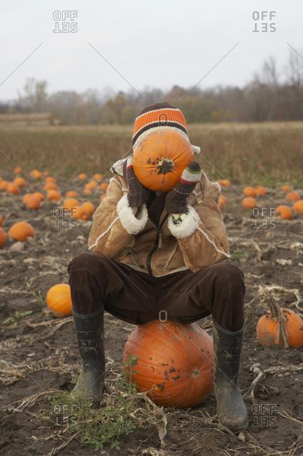 Portrait of Boy in Pumpkin Patch